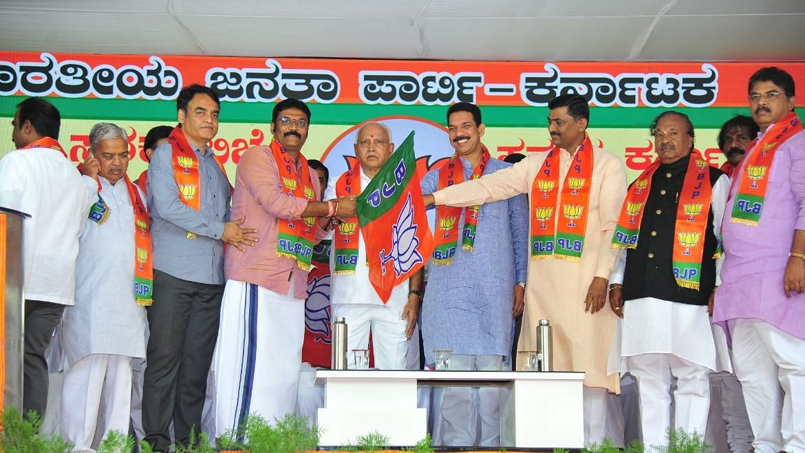 Disqualified MLA Anand Singh joining the BJP.