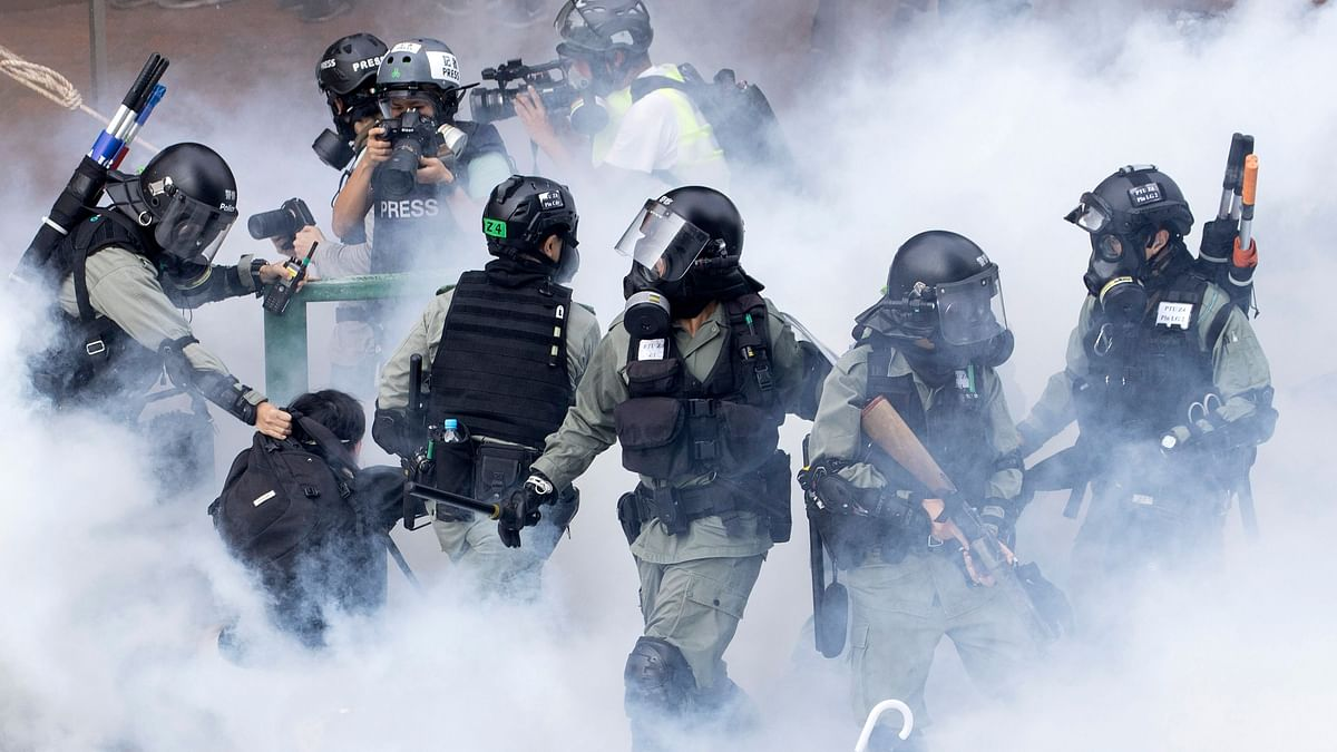 Police in riot gear move through a cloud of smoke as they detain a protester at the Hong Kong Polytechnic University in Hong Kong on Monday, 18 November 2019. Image used for representational purposes.