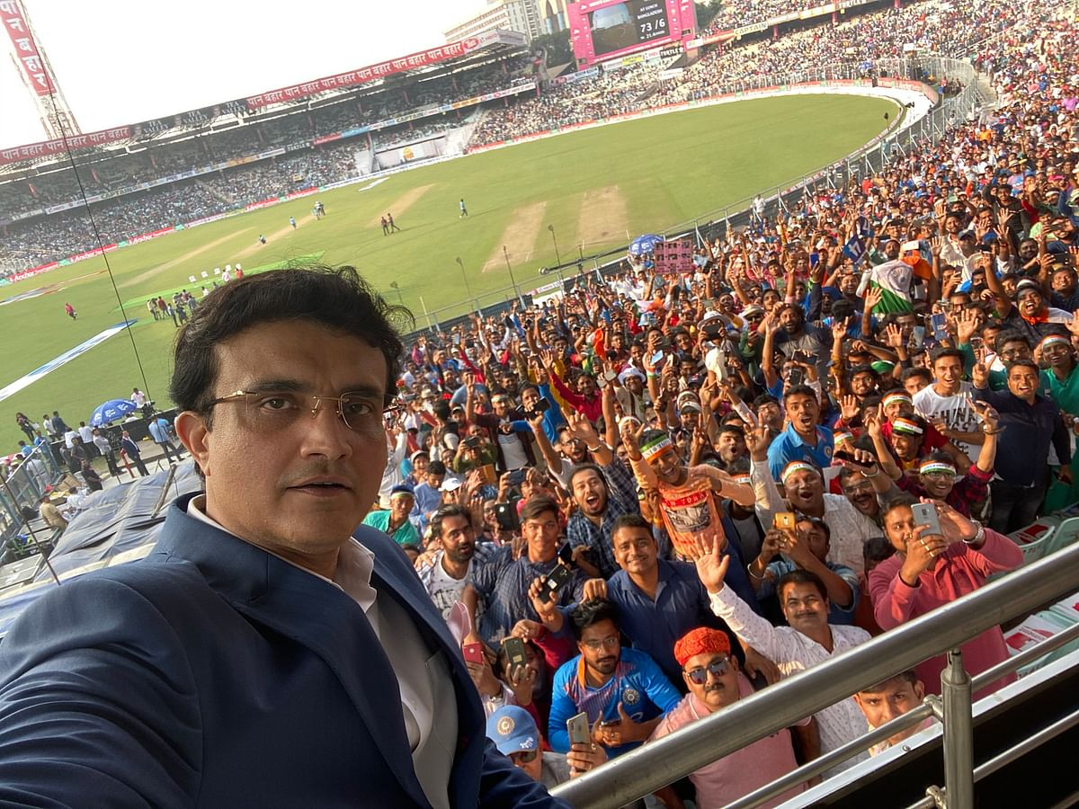 BCCI President Sourav Ganguly takes a selfie with the Eden Gardens crowd during the first day of the Pink Ball Test in Kolkata.