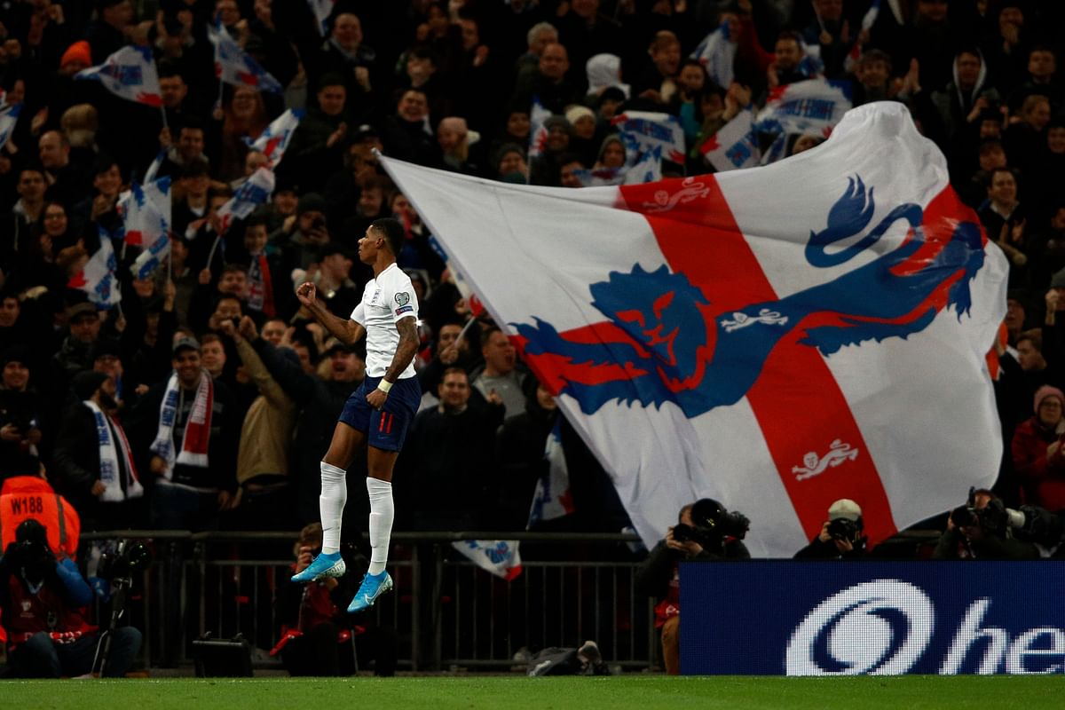 England's Marcus Rashford celebrates after scoring his side's fourth goal during the Euro 2020 group A qualifying football match between England and Montenegro at Wembley stadium in London.