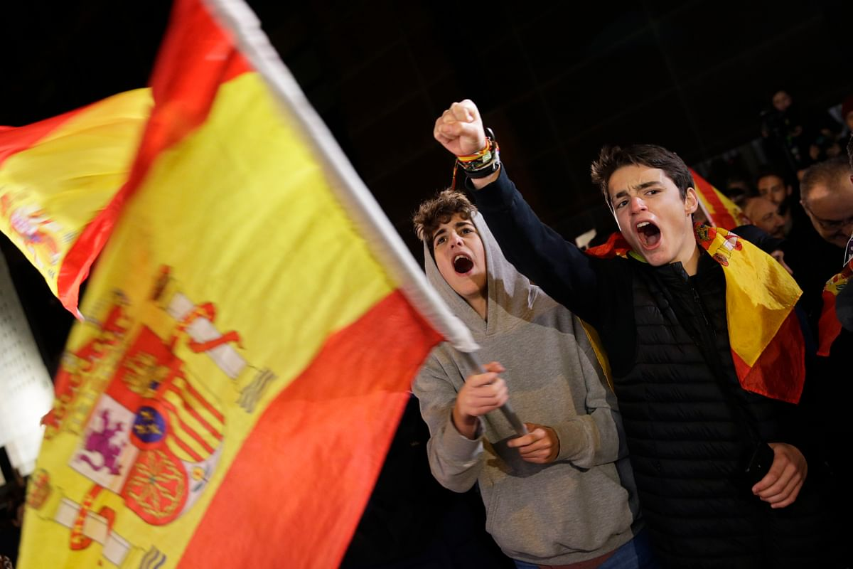 Spain's far-right Vox party supporters cheer outside the party headquarters after the announcement of the general election first results, in Madrid.