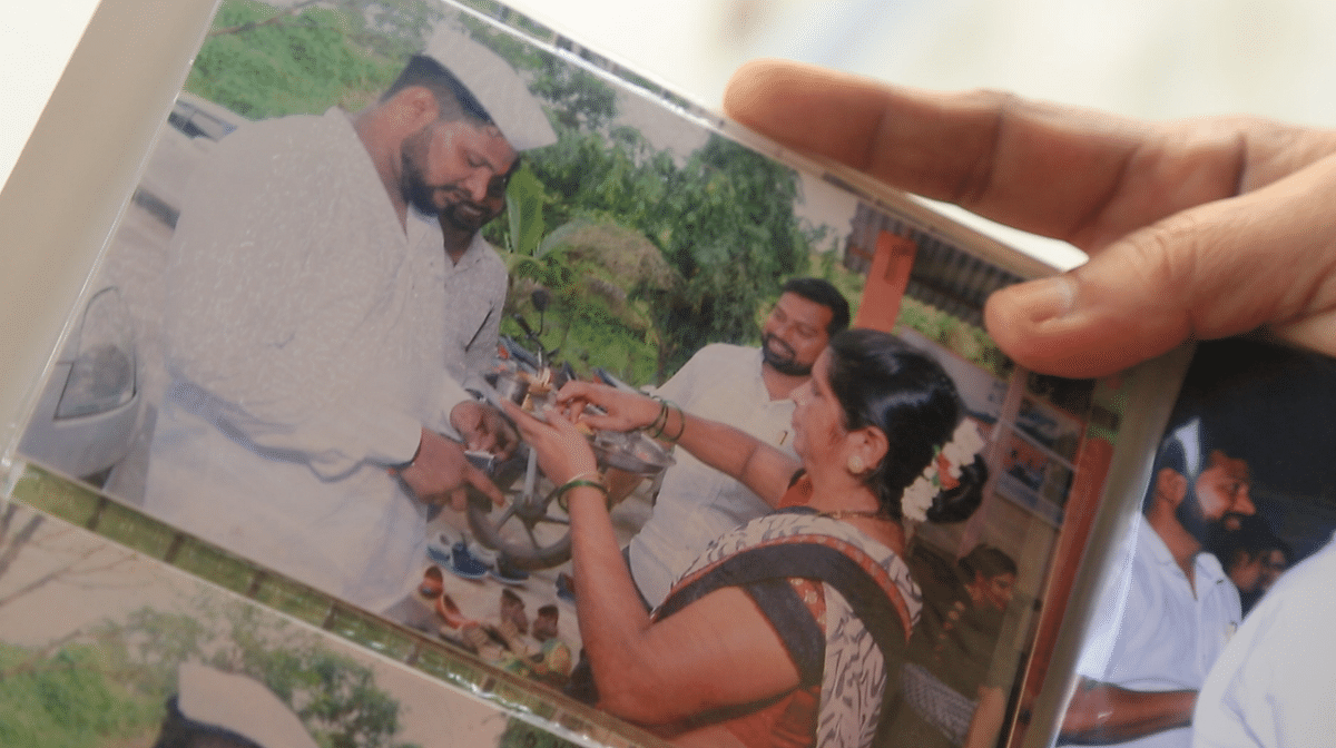 The Jadhav family clings to Kalpesh's photos.