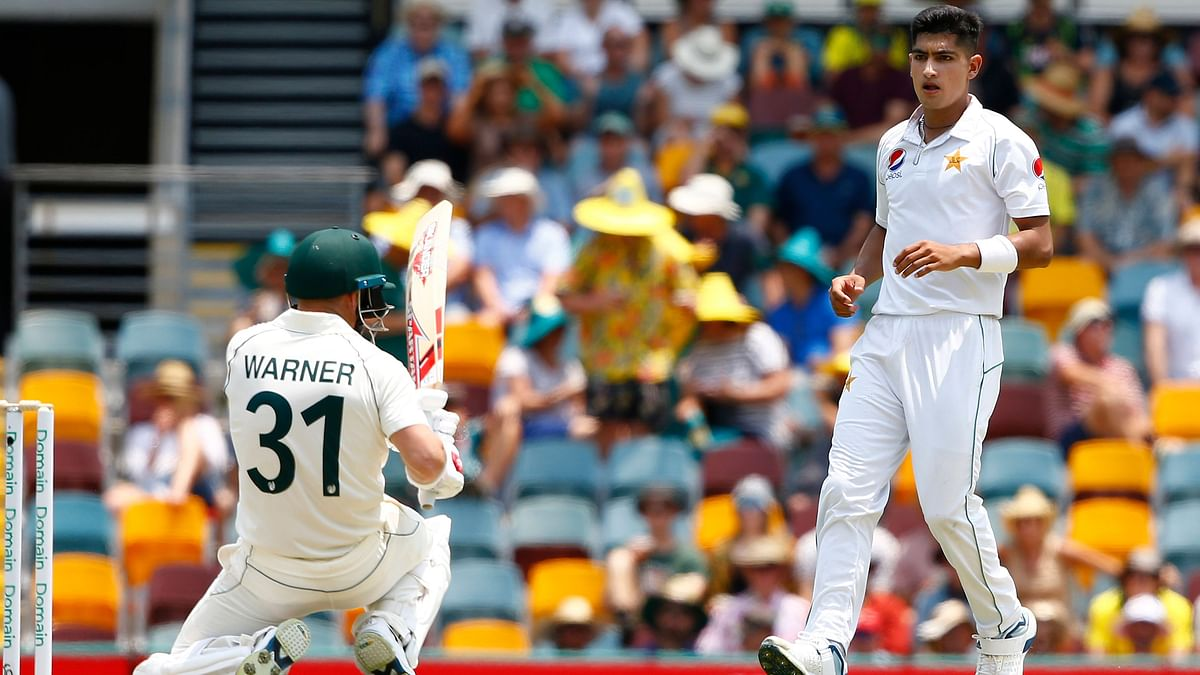 Pakistan's Naseem Shah, right, stares at Australia's David Warner, left, after he bowled a bouncer during their cricket test match against Australia in Brisbane, Australia.
