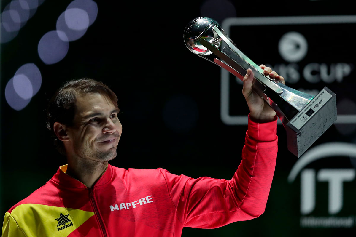 Spain's Rafael Nadal holds the tournament's best player award after Spain defeated Canada in the Davis Cup final in Madrid, Spain.