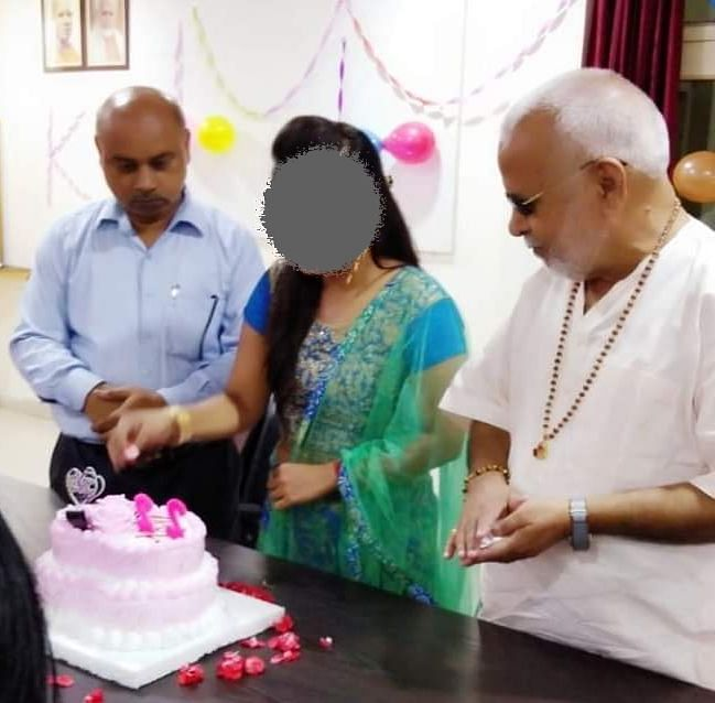 The complainant was photographed during her 22nd birthday celebrations at college. Chinmayanand is to her left and the college principal to her right.