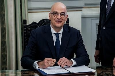 ATHENS, July 9, 2019 (Xinhua) -- Nikos Dendias, Greek Minister of Foreign Affairs, signs the protocol during the swearing-in ceremony of the new cabinet at the presidential mansion in Athens, Greece, on July 9, 2019. Greece