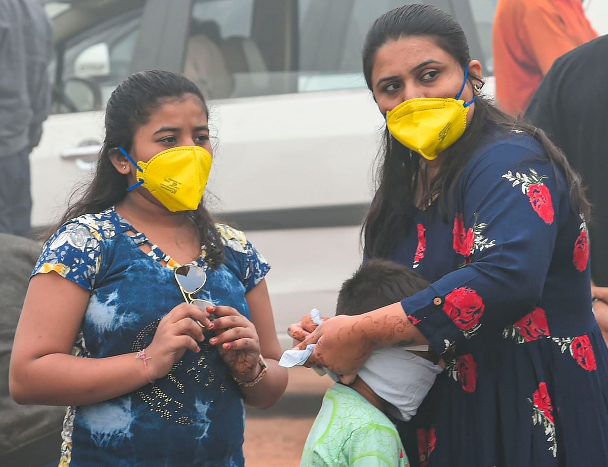 People wear masks as the air quality further dips to the hazardous 'severe plus' category.