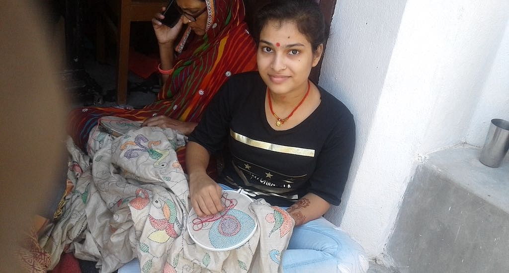 Enamored by the intricate craft, part-time students like Diksha Kumari embroider with their family members