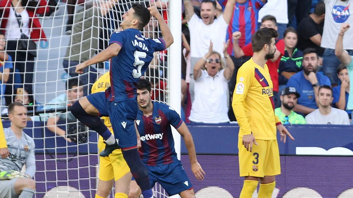 Levante scored three times in seven minutes after half-time exposing Barcelona's inability to regroup during a spell of intense pressure.