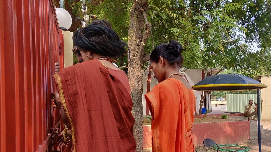 Members of the Ashram locking the entry gate located within the DPS Hirapur Campus in the outskirts of Ahmedabad city.