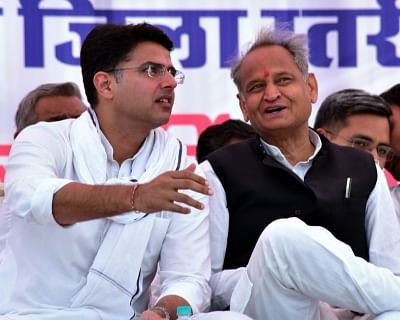 Bikaner: Rajasthan Chief Minister Ashok Gehlot in a conversation with Deputy Chief Minister Sachin Pilot during a Congress rally in Bikaner, on April 18, 2019. (Photo: IANS)