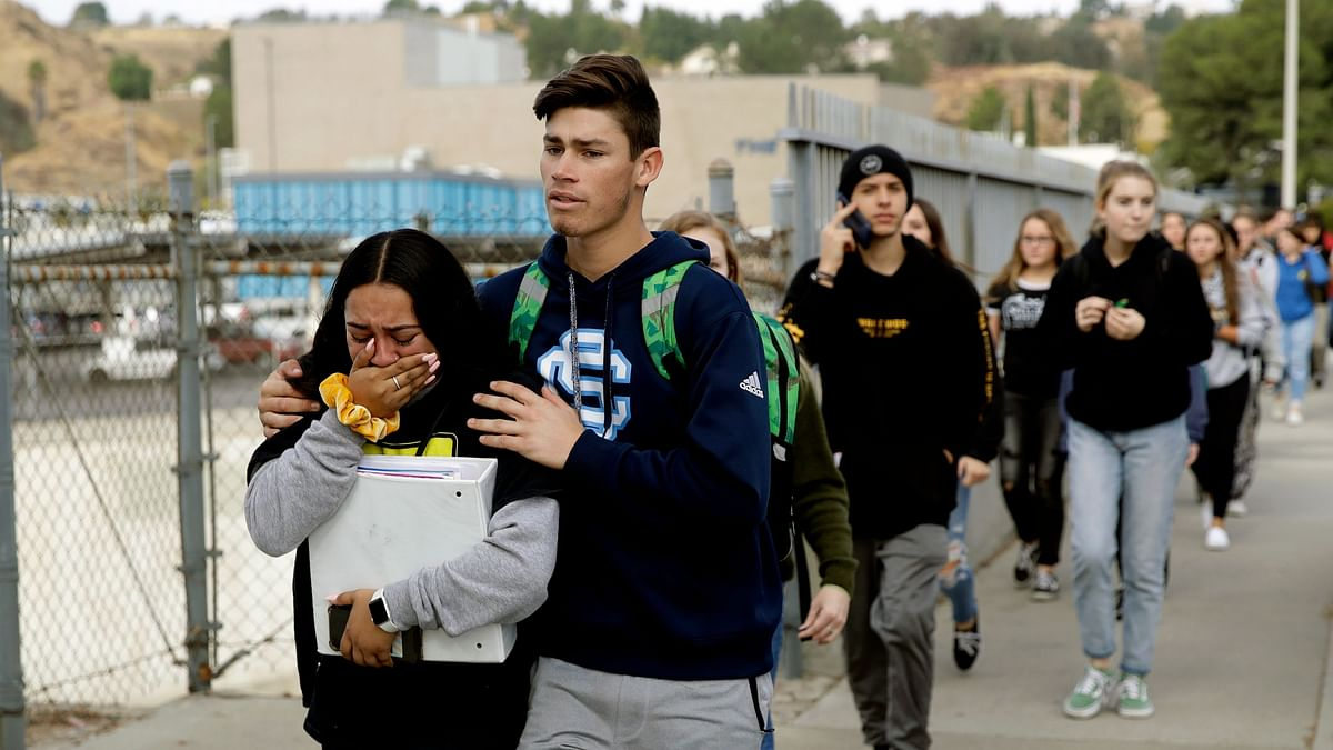 Students were escorted out of Saugus High School after reports of a shooting.