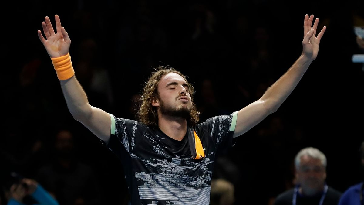 Stefanos Tsitsipas of Greece reacts after defeating Austria's Dominic Thiem to win their ATP World Finals singles final tennis match at the O2 arena in London.
