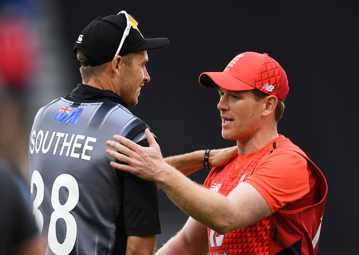 England captain Eoin Morgan consoles New Zealand captain Tim Southee, left, at the conclusion of the super over during their T20 cricket match at Eden Park, Auckland, New Zealand, Sunday, Nov. 10, 2019.