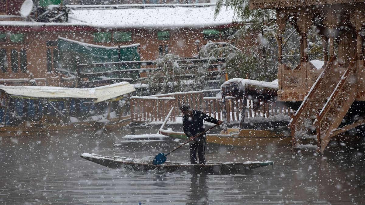 In Pics: J&K Residents Wake Up to Snow-Covered Roads, Highways