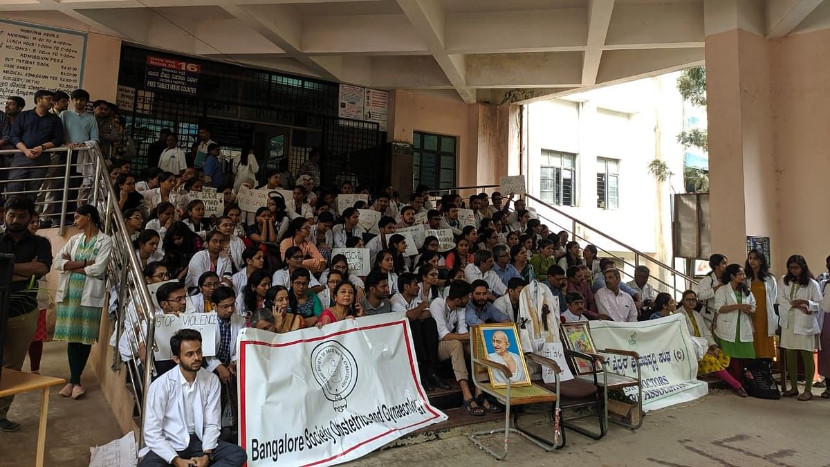 Scores of post graduate residents of Victoria Hospital sat in protest against the alleged harassment of a junior doctor at Minto Eye Hospital last week, demanding more stringent security measures.