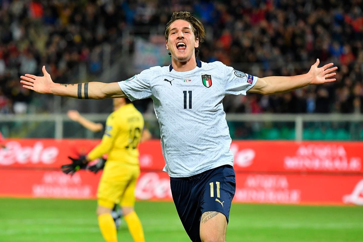 Italy's Nicolo' Zaniolo celebrates after scoring his side's second goal during a group J qualifying game between Italy and Armenia at the Renzo Barbera stadium, in Palermo, Italy.