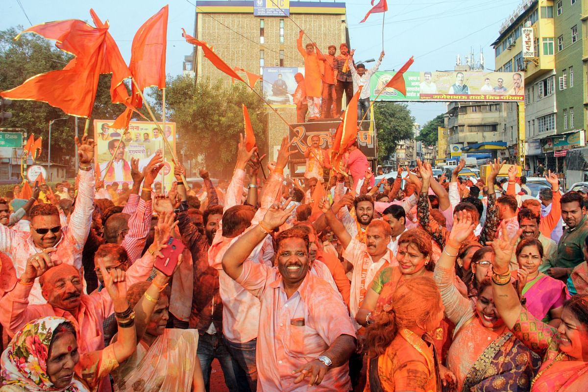 Shiv Sena supporters celebrate after their party chief Uddhav Thackeray was designated as Maharashtra's new CM.