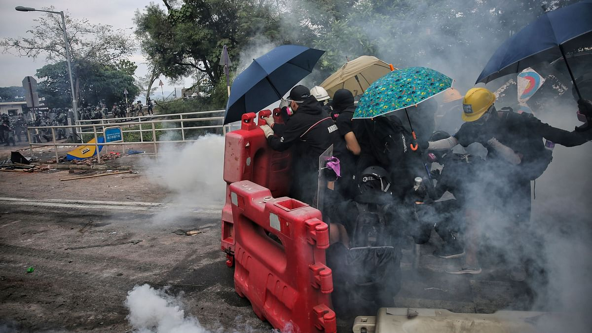 Police fired tear gas at protesters who littered streets with bricks and disrupted morning commutes.
