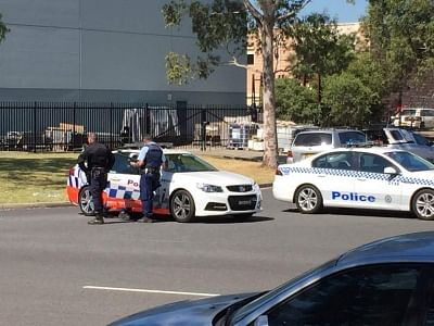 SYNDEY, March 7, 2016 (Xinhua) -- Policemen are seen near the scene of the shooting incident on the outskirts of Sydney, Australia, March 7, 2016. A man was killed and two others were injured and taken to a hospital following a shooting at a signage business in Sydney