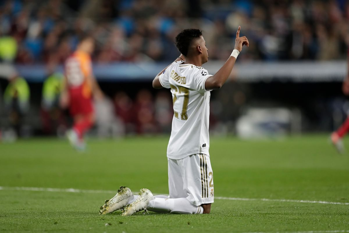 Real Madrid's Rodrygo celebrates after scoring his side's second goal during a Champions League group A game between Real Madrid and Galatasaray at the Santiago Bernabeu stadium in Madrid.