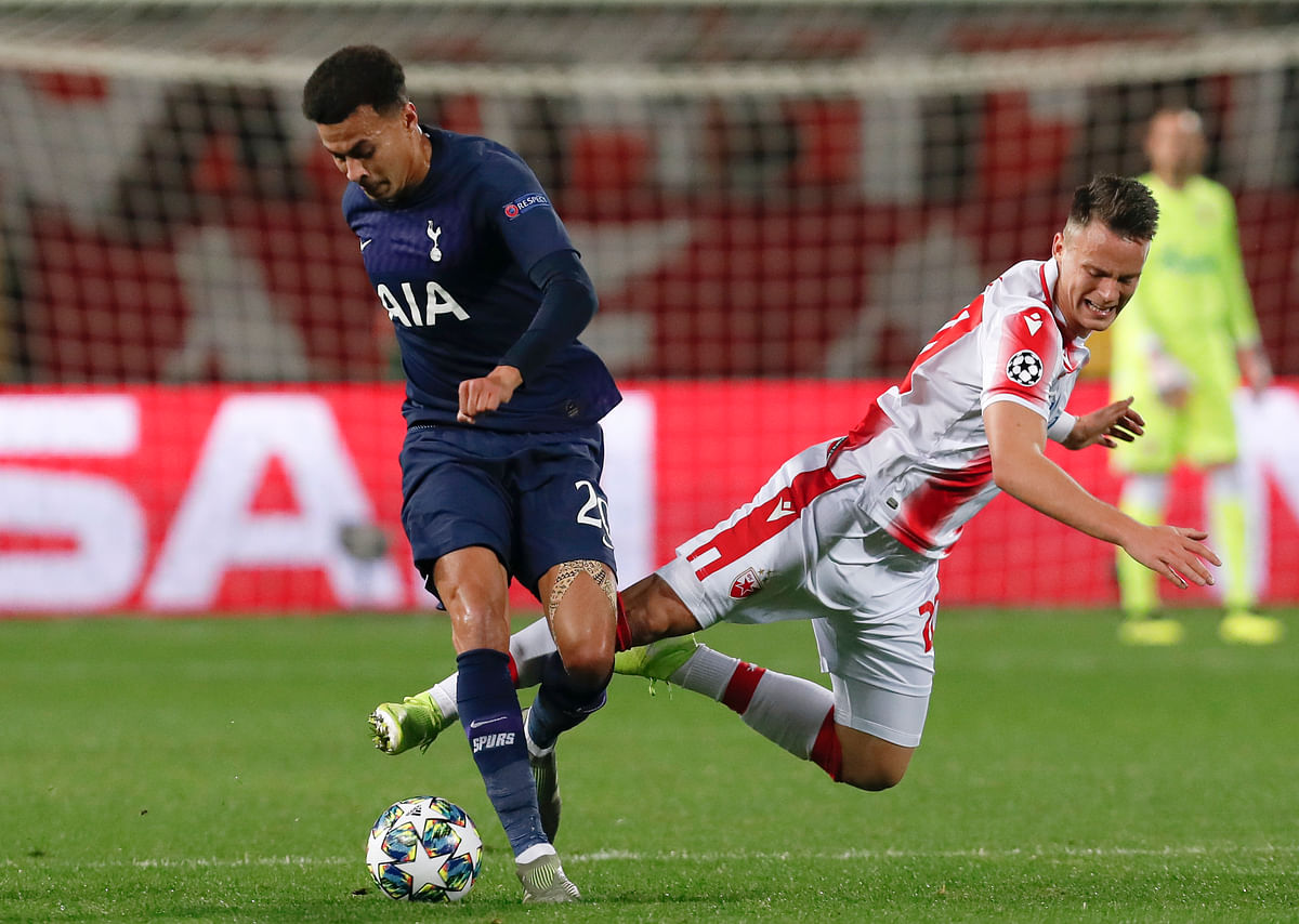 Tottenham's Dele Alli, left, challenges for the ball with Red Star's Njegos Petrovic during the Champions League group B match between Red Star and Tottenham, at the Rajko Mitic Stadium in Belgrade, Serbia.