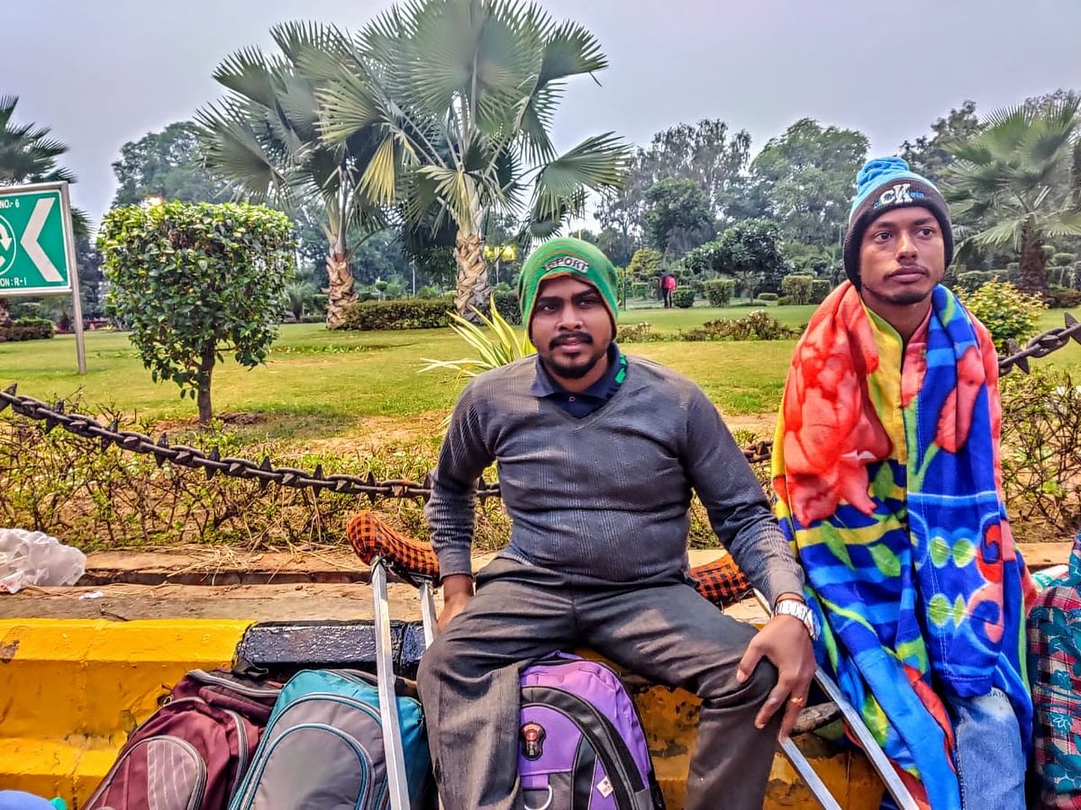 (From Left to Right) Mohammad Aslam Ansari and  Pittu Prasad Sharna  sit on cold pavement for the third day in a row.
