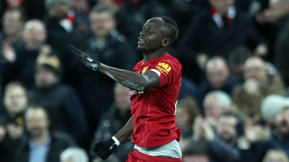 Liverpool's Sadio Mane celebrates after scoring his side's third goal during the English Premier League soccer match between Liverpool and Manchester City at Anfield stadium in Liverpool, England, Sunday, Nov. 10, 2019.