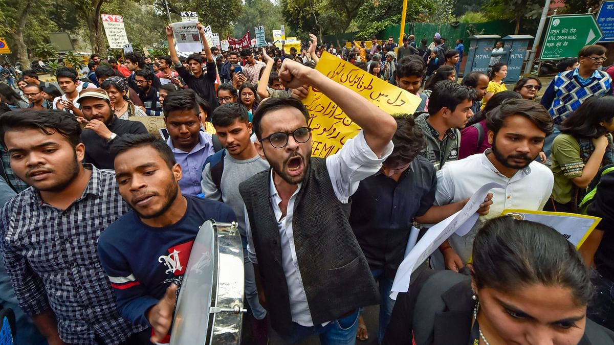File image of Umar Khalid with fellow protesters gathered at Mandi House.