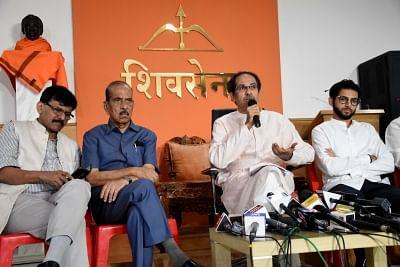 Mumbai: Shiv Sena chief Uddhav Thackeray addresses a press conference in Mumbai on Nov 8, 2019. Also seen Shiv Sena leaders Aaditya Thackeray and Sanjay Raut. (Photo: IANS)