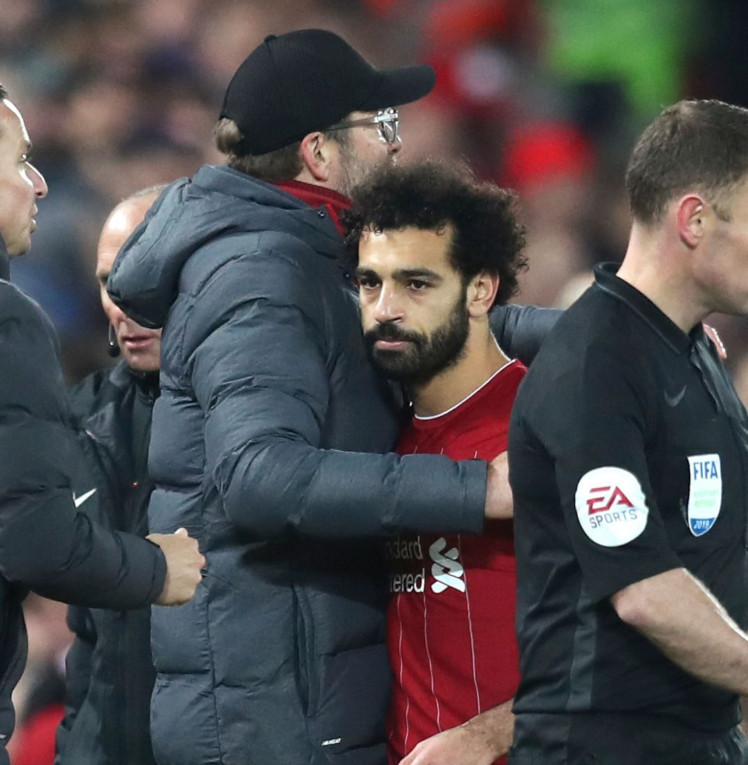 Liverpool's manager Jurgen Klopp hugs with Liverpool's Mohamed Salah as he leaves the field of play during the English Premier League soccer match between Liverpool and Manchester City at Anfield stadium in Liverpool, England, Sunday, Nov. 10, 2019.