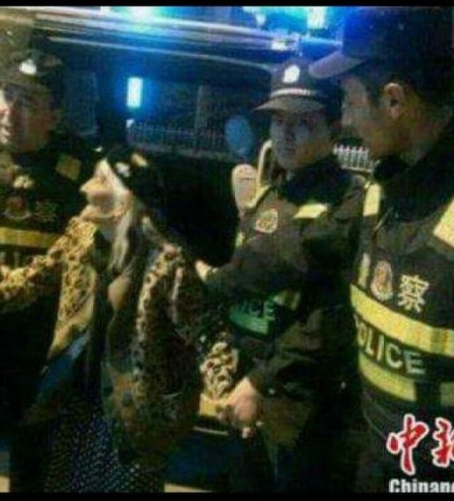 Uighur being taken to the detention centres.