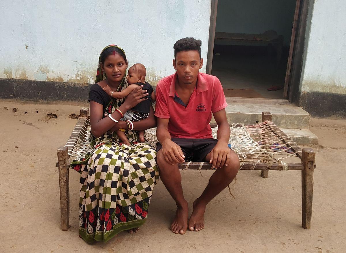 Rani Gope sitting with her husband.