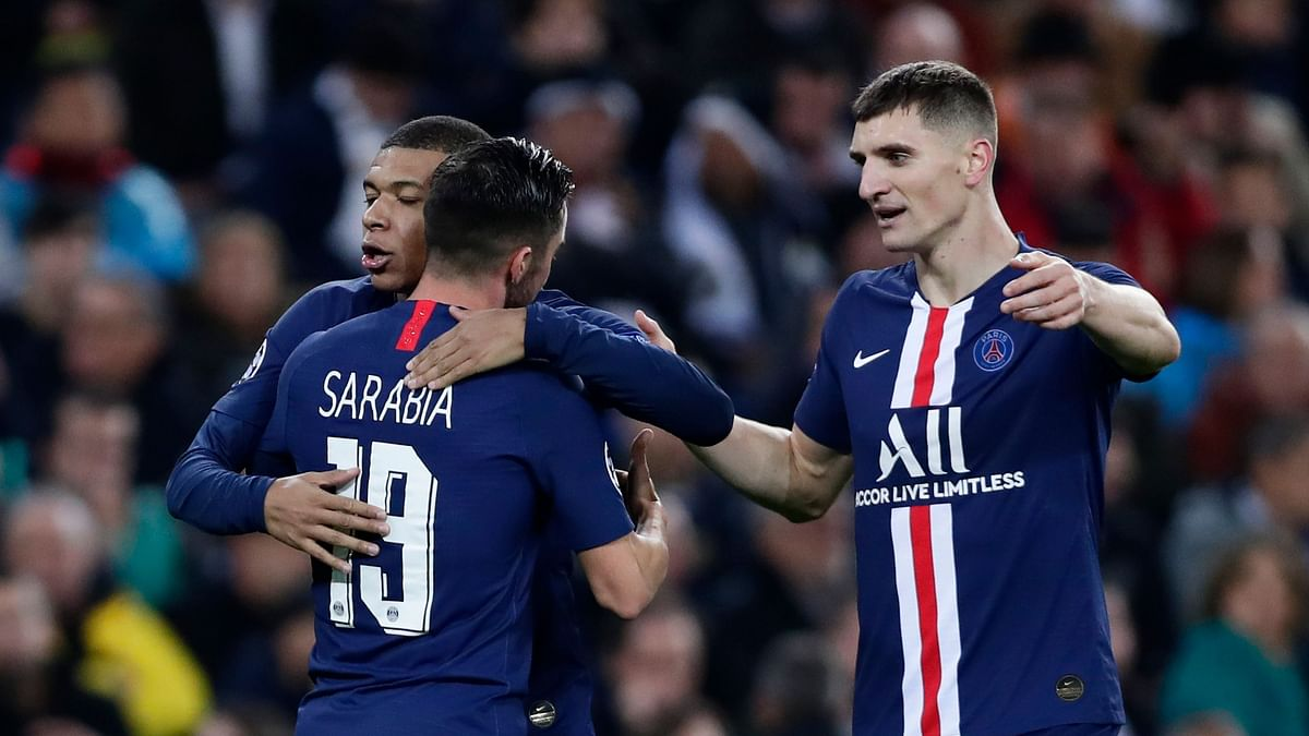 Paris Saint-Germain salvaged a 2-2 draw with Real Madrid to clinch first place in Group A of the Champions League.