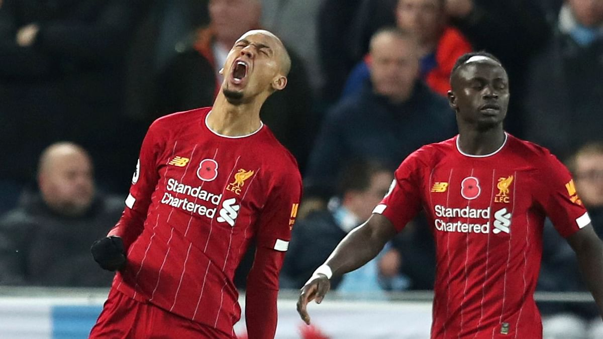 Liverpool's Fabinho celebrates after scoring his side's opening goal during the English Premier League soccer match between Liverpool and Manchester City at Anfield stadium in Liverpool, England, Sunday, Nov. 10, 2019.