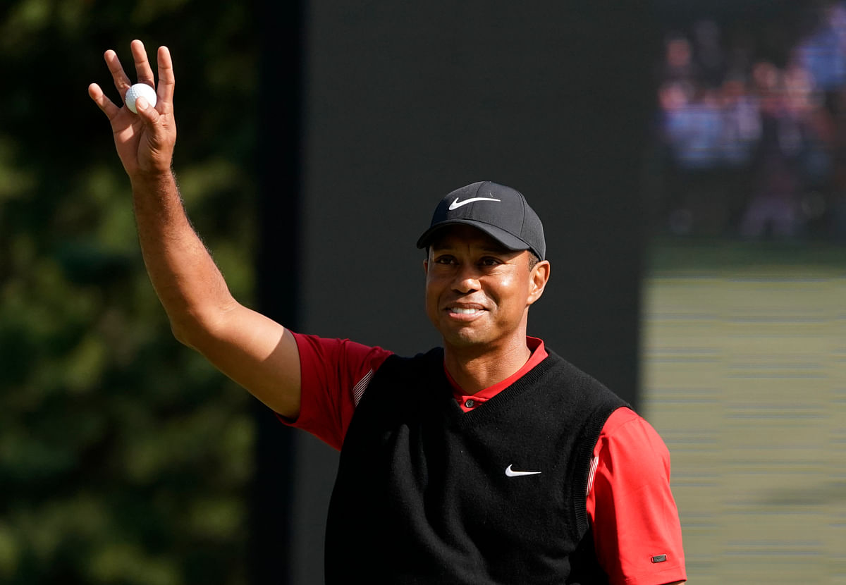 Tiger Woods  reacts after his putt on the 18th hole during the final round of the Zozo Championship PGA Tour at the Accordia Golf Narashino country club in Inzai, east of Tokyo, Japan.