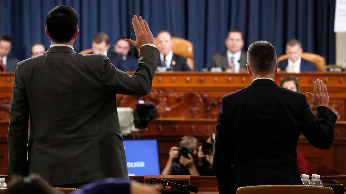 Ambassador Kurt Volker, right, former special envoy to Ukraine, and Tim Morrison, a former official at the National Security Council are sworn in to testify before the House Intelligence Committee on Capitol Hill in Washington.