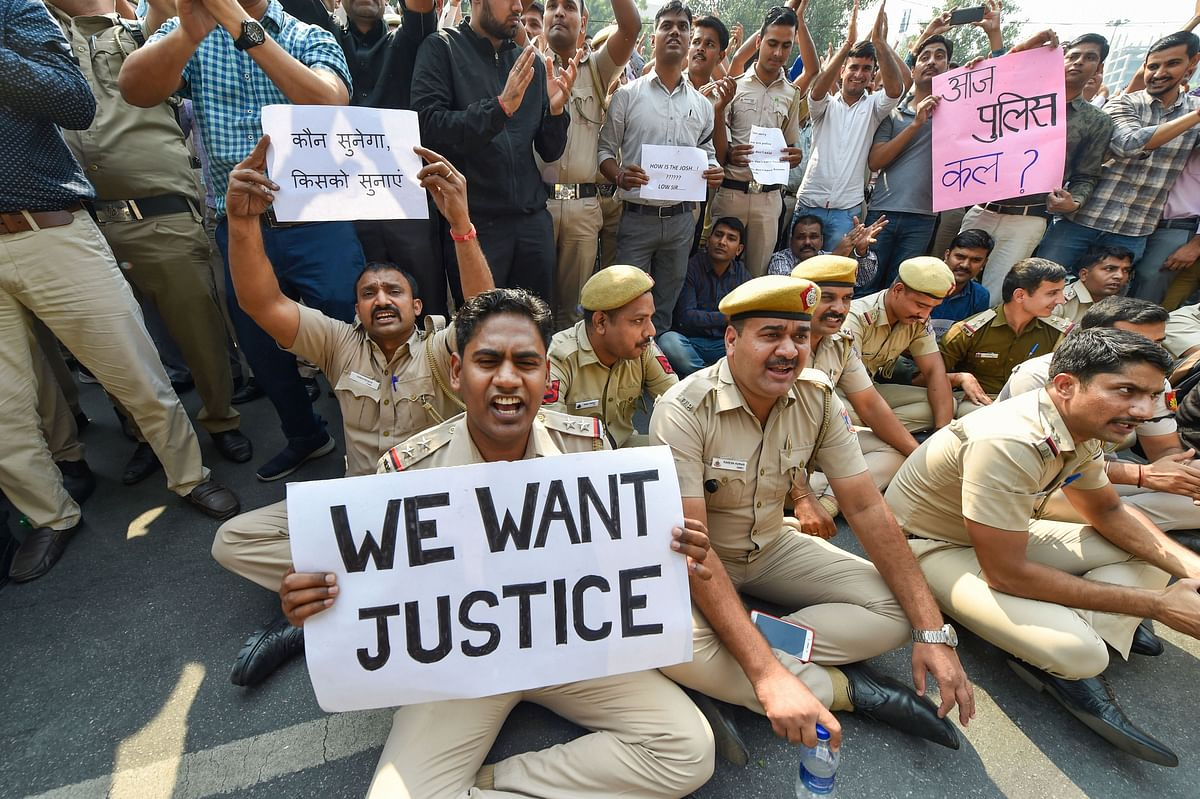Police personnel displayed placards during a protest against the repeated incidents of alleged violence against them by lawyers including the Tis Hazari Court clashes, on Tuesday, 5 November.
