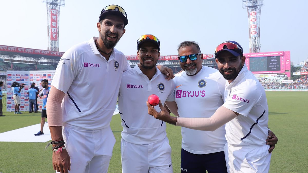 Ishant Sharma (left), Umesh Yadav, and Mohammed Shami (right) with the Indian team bowling coach Bharat Arun (centre)  at Eden Gardens.