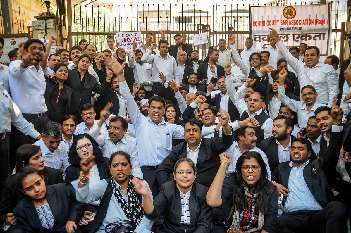 Advocates staged a protest outside Rohini Court over clashes between lawyers and police at Tis Hazari Court complex, in New Delhi, on Wednesday, 6 November.
