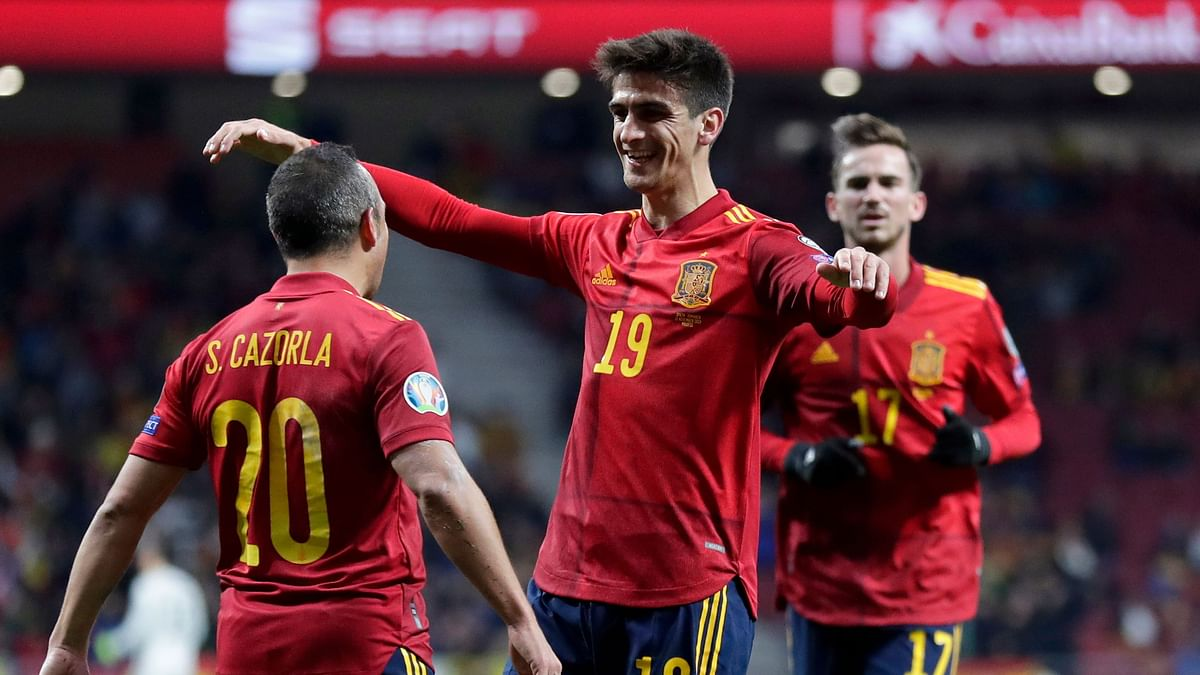 Spain's Gerard Moreno celebrates with Santi Carzola, left, after scoring his side's second goal during the Euro 2020 group F qualifying game between Spain and Romania at the Metropolitano stadium in Madrid.