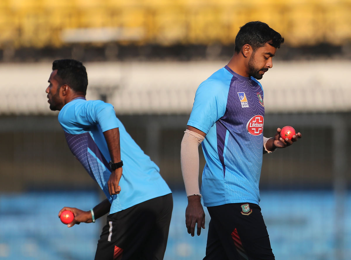 Bangladesh's Abu Jayed, right, and Ebadot Hossain hold the new pink balls as they prepare to bowl in the nets during a training session.