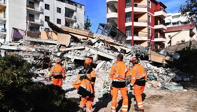 TIRANA, Nov. 28, 2019 (Xinhua) -- Rescuers search for survivors at a site of a collapsed building in Durres, Albania, Nov. 27, 2019. An earthquake measuring 6.3 on Richter scale that hit the Balkan country early Tuesday morning has claimed 30 lives so far, according to the Defense Ministry. (Xinhua/Zhang Liyun/IANS)
