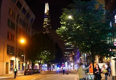 LONDON, June 4, 2017 (Xinhua) -- Journalists report near the London Bridge in London, Britain, on June 3, 2017. Unidentified attackers drove a van into pedestrians on London Bridge Saturday night and stabbed people in the nearby Borough Market area. British authorities have classified the incidents as terrorist attacks. (Xinhua/Xu Hui/IANS)