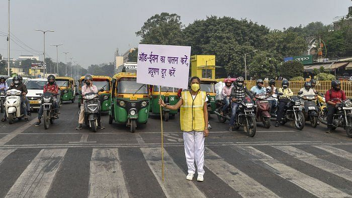 A Civil Defence vounteer displays placard asking people to abide by odd-even scheme. Image used for representational purposes.