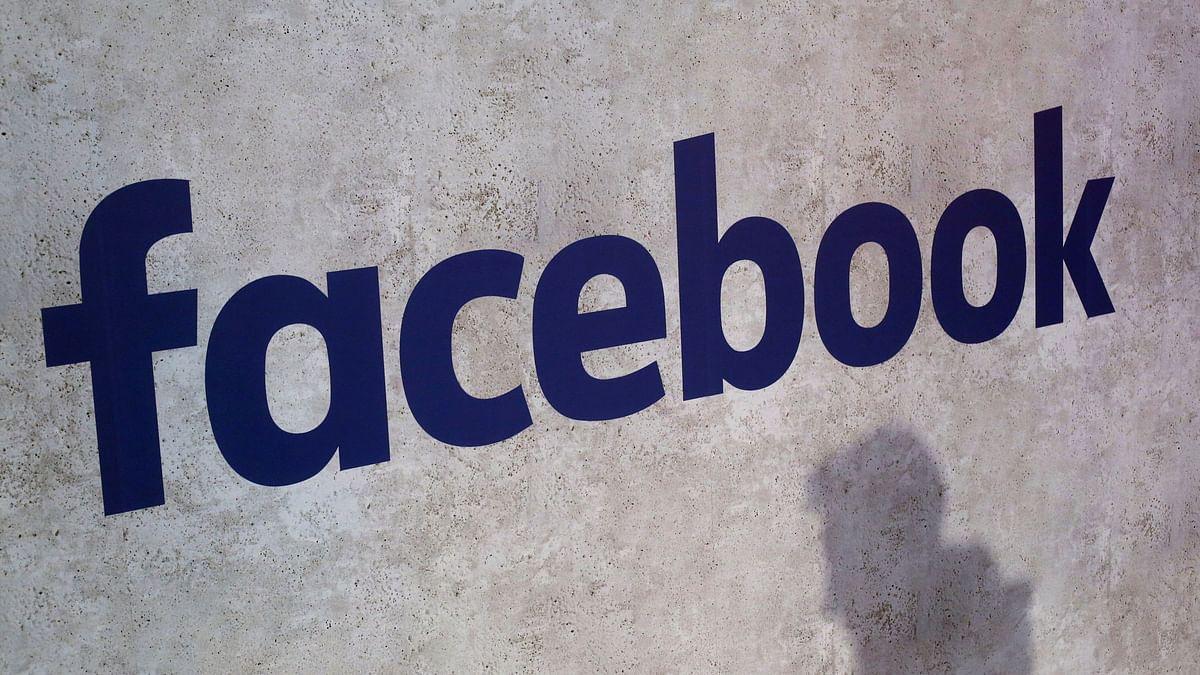 Facebook logo displayed at a business gathering in Paris