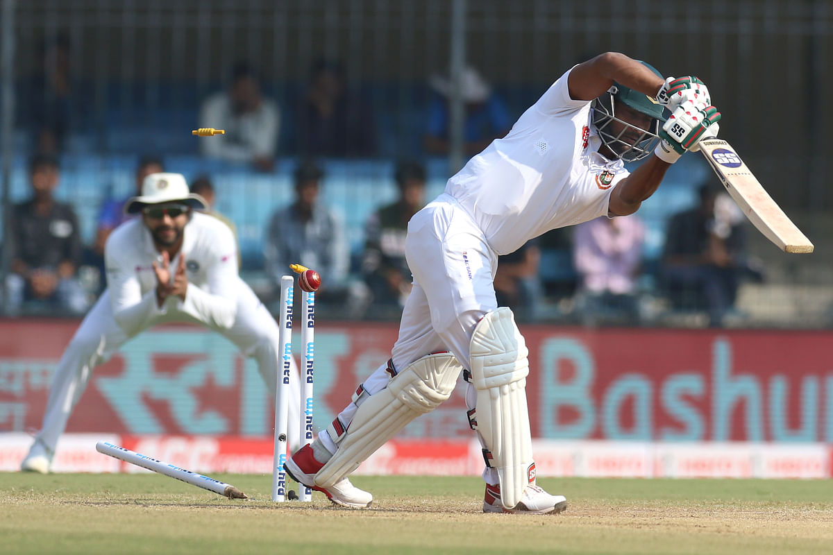 Imrul Kayes of Bangladesh is bowled by Umesh Yadav of India during day three of the the 1st Test match between India and Bangladesh.