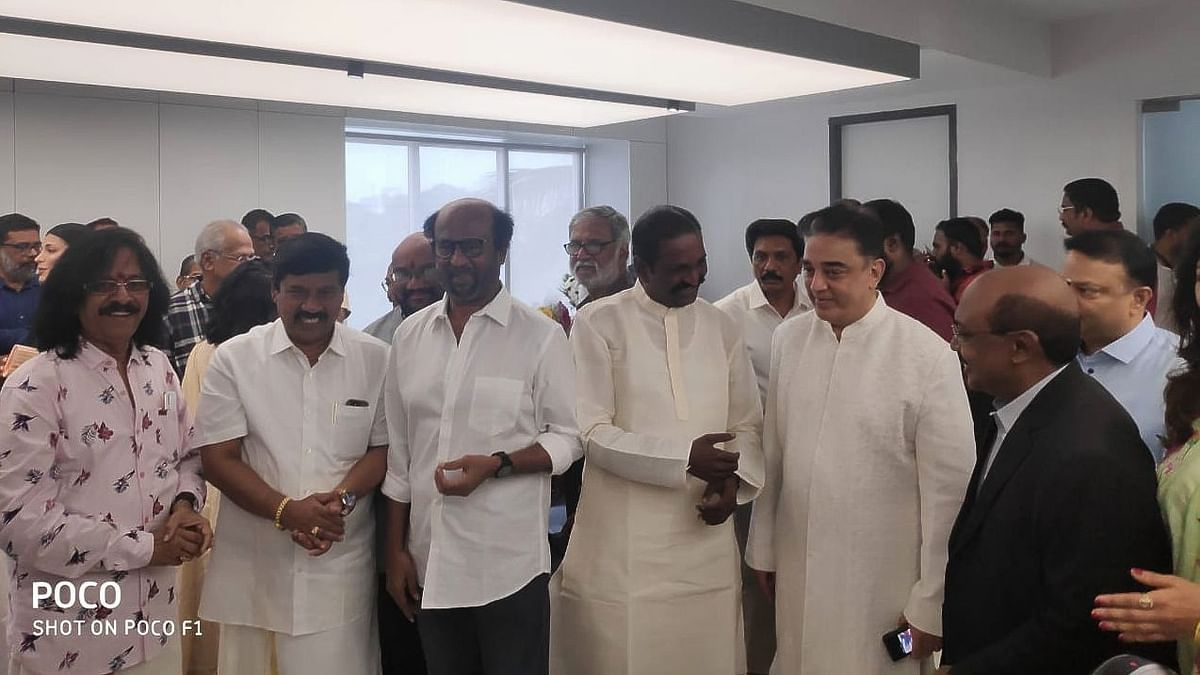 Actor Rajinikanth, lyricist Vairamuthu and musician Rajhesh Vaidhya with actor Kamal Haasan.