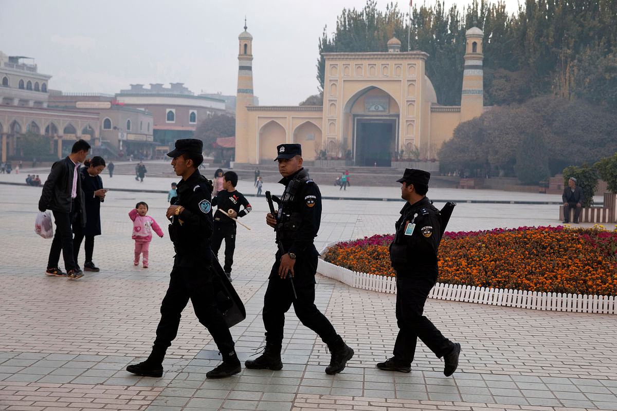 File photo of Uighur security personnel patrolling near the Id Kah Mosque in Kashgar in western China's Xinjiang region.
