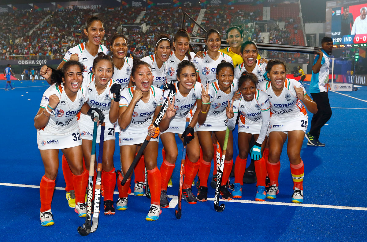 The Indian women's hockey team celebrate their Olympic qualification after the match against USA on Saturday.